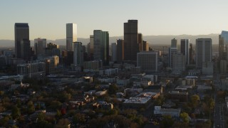 DX0001_001809 - 5.7K stock footage aerial video slowly flying by the skyline at sunset in Downtown Denver, Colorado