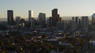 DX0001_001812 - 5.7K stock footage aerial video slowly ascend and flyby the skyline at sunset, Downtown Denver, Colorado