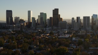 DX0001_001813 - 5.7K stock footage aerial video slowly descent while flying by the skyline at sunset, Downtown Denver, Colorado