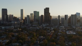 DX0001_001814 - 5.7K stock footage aerial video slowly ascend while flying by the skyline at sunset, Downtown Denver, Colorado
