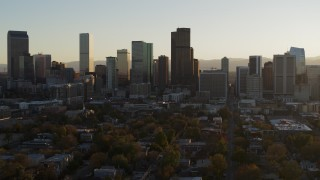 DX0001_001815 - 5.7K stock footage aerial video slowly descend while focusing on the skyline at sunset, Downtown Denver, Colorado