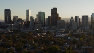 DX0001_001816 - 5.7K stock footage aerial video a slow pass by the skyline in Downtown Denver, Colorado at sunset