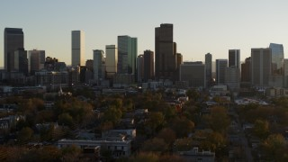 DX0001_001817 - 5.7K stock footage aerial video a slow pass by the skyline before ascent at sunset, Downtown Denver, Colorado