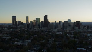DX0001_001828 - 5.7K stock footage aerial video ascend while approaching the city skyline at sunset, Downtown Denver, Colorado