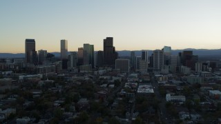 DX0001_001835 - 5.7K stock footage aerial video of the city skyline at sunset while approaching and ascending, Downtown Denver, Colorado
