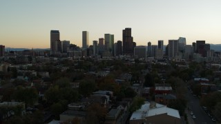 DX0001_001838 - 5.7K stock footage aerial video of a reverse view of the city skyline at sunset, Downtown Denver, Colorado
