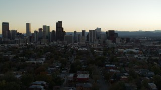 DX0001_001839 - 5.7K stock footage aerial video approach of the city skyline at sunset during ascent, Downtown Denver, Colorado