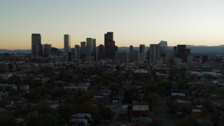 DX0001_001840 - 5.7K stock footage aerial video fly away from the city skyline at sunset during descent, Downtown Denver, Colorado