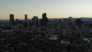 DX0001_001842 - 5.7K stock footage aerial video flyby the city skyline at sunset during descent, Downtown Denver, Colorado