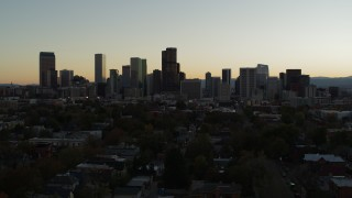 DX0001_001845 - 5.7K stock footage aerial video of flying by the city's skyline at sunset in Downtown Denver, Colorado