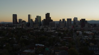 DX0001_001847 - 5.7K stock footage aerial video of flying by the city's skyline at sunset and descending in Downtown Denver, Colorado