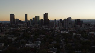 DX0001_001851 - 5.7K stock footage aerial video slow ascent while flying by the city's skyline at sunset, Downtown Denver, Colorado