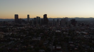 DX0001_001853 - 5.7K stock footage aerial video slowly flying away from the city's skyline at sunset, Downtown Denver, Colorado