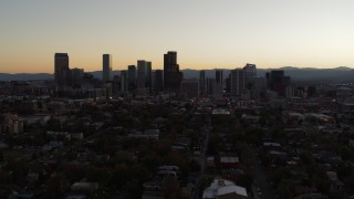 DX0001_001854 - 5.7K stock footage aerial video slow descent with view of the city's skyline at sunset, Downtown Denver, Colorado