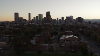 DX0001_001855 - 5.7K stock footage aerial video of approaching the city's skyline at sunset, Downtown Denver, Colorado