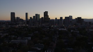 DX0001_001861 - 5.7K stock footage aerial video ascend and approach the city's skyline at twilight, Downtown Denver, Colorado