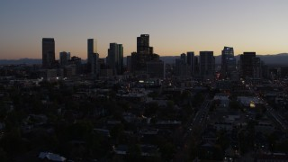 DX0001_001862 - 5.7K stock footage aerial video of the city's skyline at twilight while flying away, Downtown Denver, Colorado