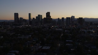 DX0001_001863 - 5.7K stock footage aerial video of flying by the city's skyline at twilight, Downtown Denver, Colorado