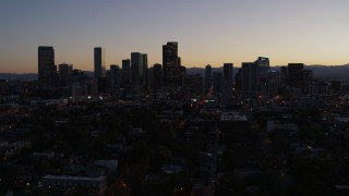 DX0001_001866 - 5.7K stock footage aerial video ascend and approach the city's skyline at twilight, Downtown Denver, Colorado