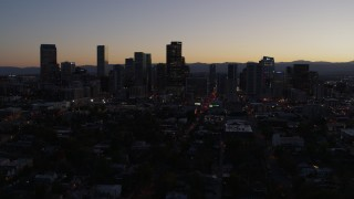 DX0001_001867 - 5.7K stock footage aerial video fly away from the city's skyline at twilight and ascend, Downtown Denver, Colorado