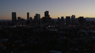 DX0001_001868 - 5.7K stock footage aerial video flying by the city's skyline at twilight and descend, Downtown Denver, Colorado