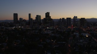 DX0001_001872 - 5.7K stock footage aerial video of passing the city's skyline at twilight during slow ascent, Downtown Denver, Colorado