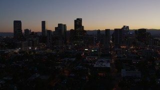DX0001_001874 - 5.7K stock footage aerial video of a slow descent while focusing on the city's skyline at twilight, Downtown Denver, Colorado