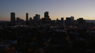 DX0001_001875 - 5.7K stock footage aerial video of a stationary view of the city's skyline at twilight, Downtown Denver, Colorado