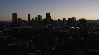 DX0001_001876 - 5.7K stock footage aerial video of a reverse view of the city's skyline at twilight and ascend, Downtown Denver, Colorado