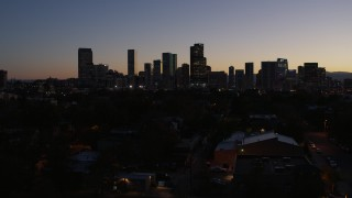 DX0001_001878 - 5.7K stock footage aerial video of a slow approach to the city's skyline at twilight and ascend, Downtown Denver, Colorado