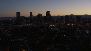 DX0001_001880 - 5.7K stock footage aerial video fly away from and by the city's skyline at twilight, Downtown Denver, Colorado