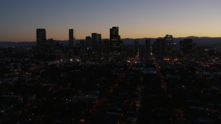 DX0001_001881 - 5.7K stock footage aerial video fly toward the city's skyline at twilight, Downtown Denver, Colorado