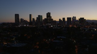 DX0001_001883 - 5.7K stock footage aerial video of passing by the city's skyline at twilight, Downtown Denver, Colorado