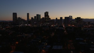 DX0001_001885 - 5.7K stock footage aerial video of a reverse view of the city's skyline at twilight, Downtown Denver, Colorado