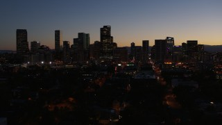 DX0001_001887 - 5.7K stock footage aerial video fly away from the city's skyline at twilight and descend, Downtown Denver, Colorado