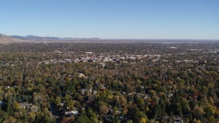 DX0001_001890 - 5.7K stock footage aerial video ascend for a view of Boulder, Colorado and surrounding neighborhoods