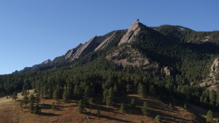 DX0001_001901 - 5.7K stock footage aerial video of flying by Green Mountain's flatirons in the Rocky Mountains, Colorado