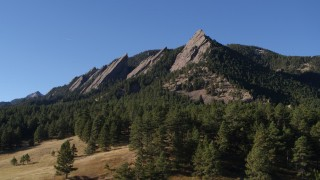 DX0001_001902 - 5.7K stock footage aerial video of flying by trees and Green Mountain's flatirons in the Rocky Mountains, Colorado