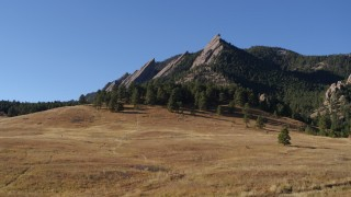 DX0001_001903 - 5.7K stock footage aerial video of reverse view of Green Mountain's flatirons before descending in the Rocky Mountains, Colorado
