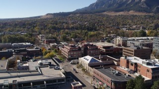 DX0001_001904 - 5.7K stock footage aerial video brick office building at quiet intersection in Boulder, Colorado