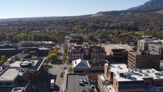 DX0001_001905 - 5.7K stock footage aerial video flying by brick office building at quiet intersection in Boulder, Colorado