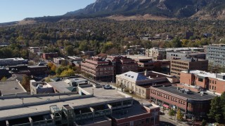 DX0001_001906 - 5.7K stock footage aerial video of a brick office building at quiet intersection seen while descending in Boulder, Colorado