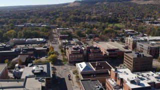 DX0001_001907 - 5.7K stock footage aerial video ascend and flyby a brick office building at quiet intersection in Boulder, Colorado