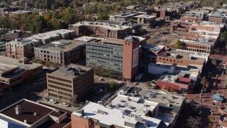 DX0001_001909 - 5.7K stock footage aerial video approach a brick office building and ascend in Boulder, Colorado