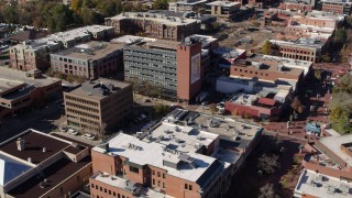 DX0001_001910 - 5.7K stock footage aerial video fly away from a brick office building and descend in Boulder, Colorado