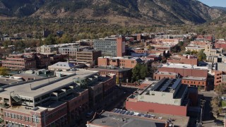 DX0001_001912 - 5.7K stock footage aerial video of flying away from brick office buildings in Boulder, Colorado