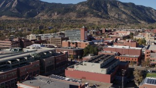 DX0001_001914 - 5.7K stock footage aerial video fly over shops and office buildings to approach a taller office building in Boulder, Colorado