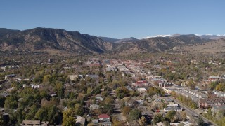 DX0001_001916 - 5.7K stock footage aerial video a stationary view of Boulder, Colorado with mountains in background