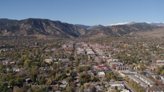 DX0001_001918 - 5.7K stock footage aerial video ascend to stationary view of Boulder, Colorado with mountains in background
