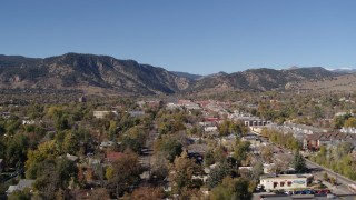 DX0001_001920 - 5.7K stock footage aerial video ascend and flyby Boulder, Colorado with mountains in background